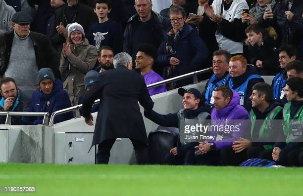 Manager of Spurs Jose Mourinho thanks the ball kid who help set up a goal during the UEFA Champions League group B match between Tottenham Hotspur...