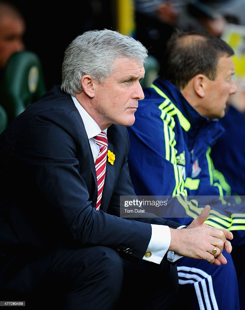 Manager of Stoke City Mark Hughes look on during the Barclays Premier League match between Norwich City and Stoke City at Carrow Road on March 08, 2014 in Norwich, England.