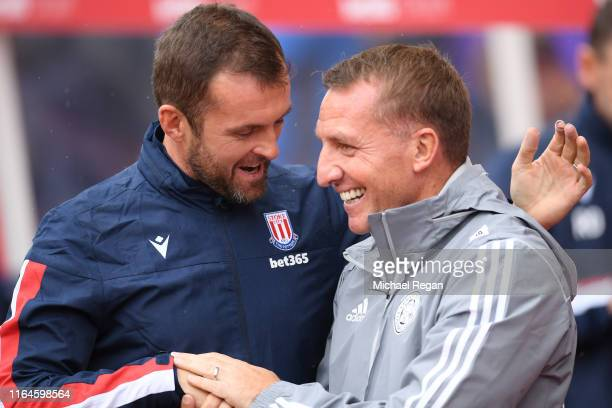 Manager of Stoke Nathan Jones speaks to Leicester manager Brendan Rodgers during the PreSeason Friendly match between Stoke City and Leicester City...