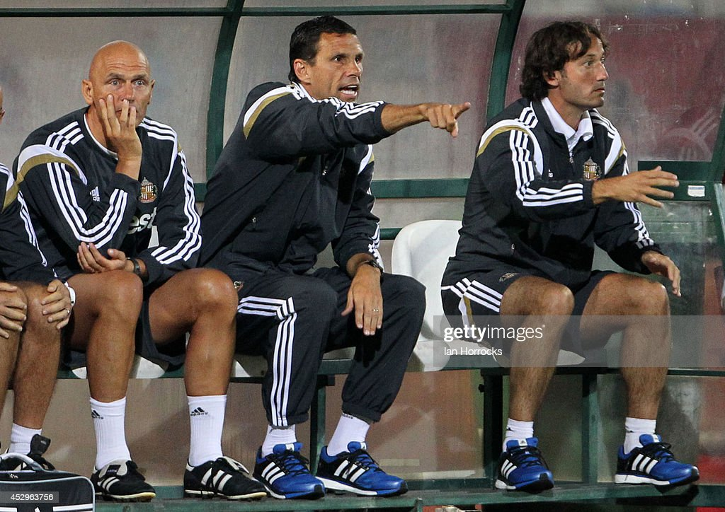 Manager of Sunderland Gus Poyet (C) during a pre-season friendly match between CD National and Sunderland at the Estadio Municipal Albufeira on July 30, 2014 in Albufeira, Portugal.
