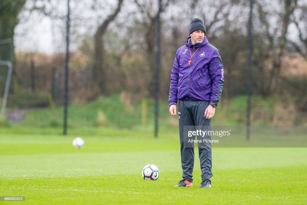 Manager of Swansea City, Paul Clement looks on during the Swansea City training session at The Fairwood training Ground on March 30, 2017 in Swansea, Wales.