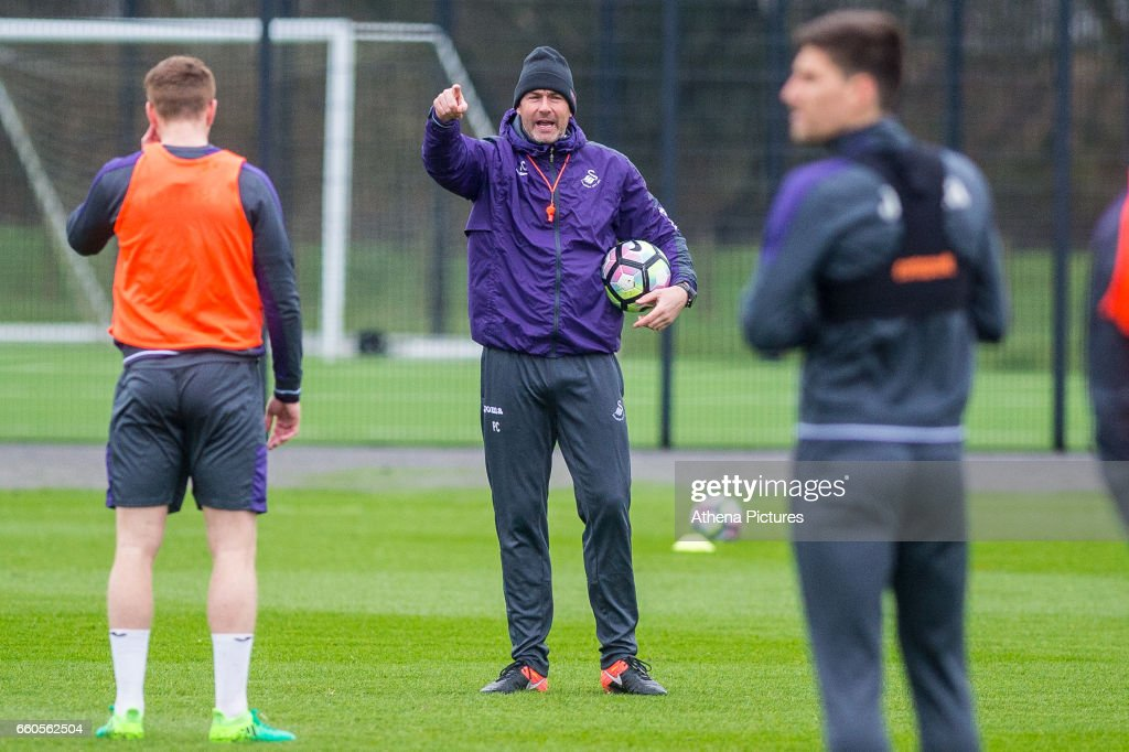Manager of Swansea City, Paul Clement talks to players during the Swansea City training session at The Fairwood training Ground on March 30, 2017 in Swansea, Wales.