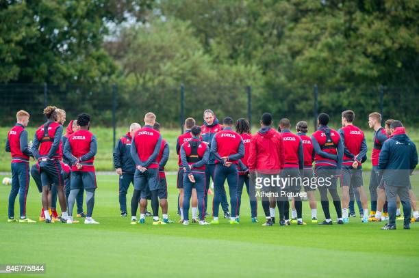 Manager of Swansea City Paul Clement talks to players during the Swansea City training session at The Fairwood training Ground on September 13 2017...
