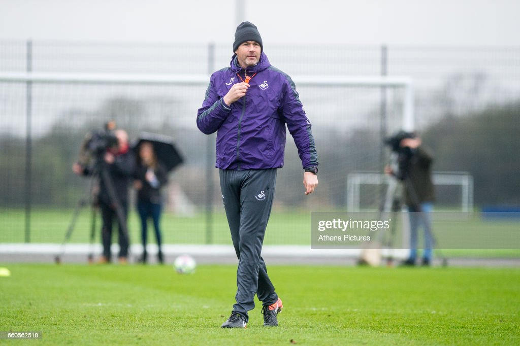 Manager of Swansea City, Paul Clementlooks on during the Swansea City training session at The Fairwood training Ground on March 30, 2017 in Swansea, Wales.