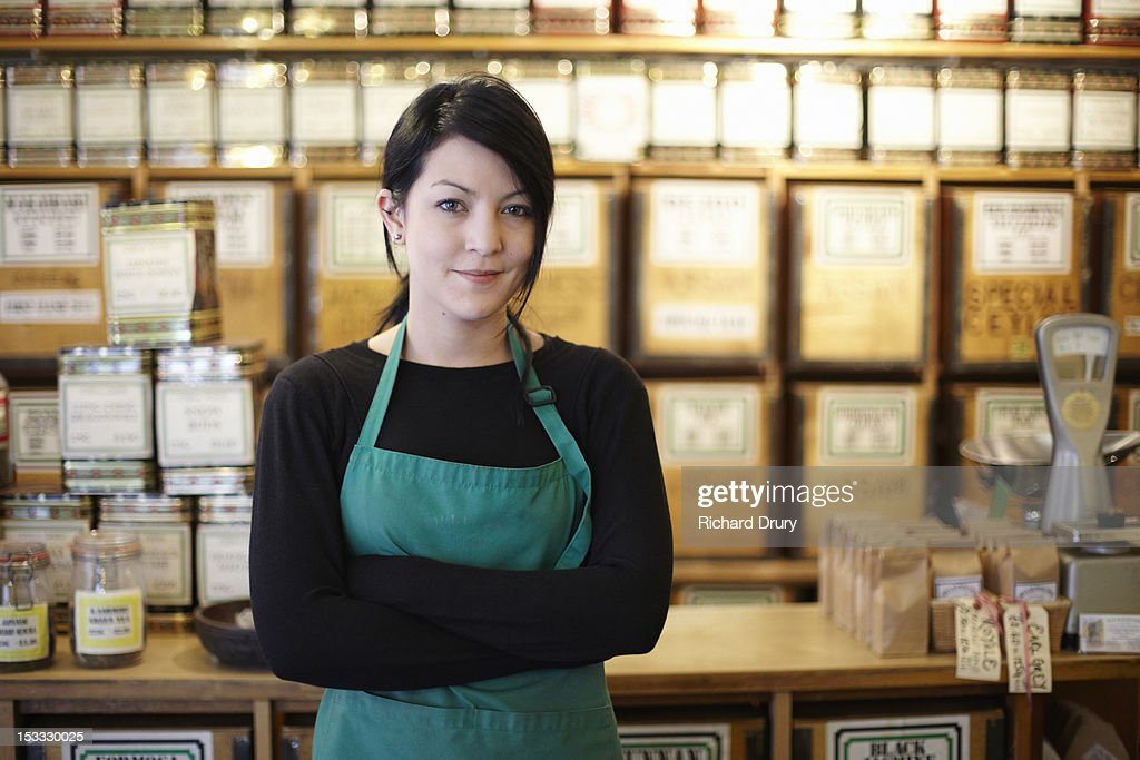 Manager of tea and coffee store in her shop : Stock Photo