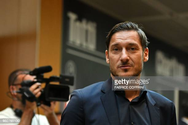 Manager of the AS Roma football club Francesco Totti arrives ahead of the draw for the quarter finals round of the UEFA Champions League football...