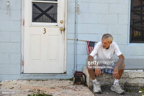 Manager of the Coral Sands Trailer Park Bruce Ramsey takes a break from cleaning up debris that littered the Florida Keys complex following Hurricane...
