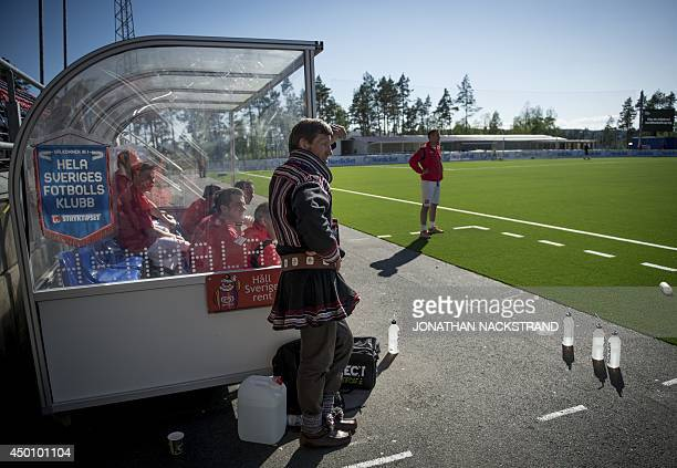 Manager of the Sapmi football team Isaac Ole Hetta wears sami traditional clothing while watching his players during the CONIFA World Football Cup...