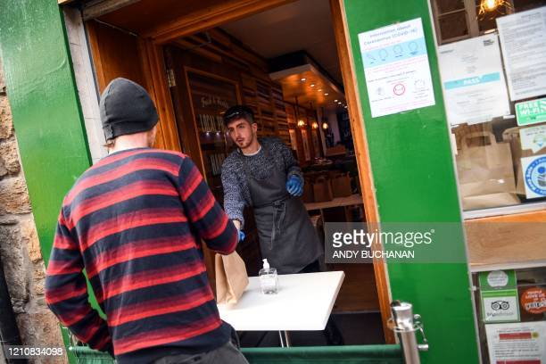 Manager of the Social Bite cafe Rory Bancroft distributes free lunches to homeless and needy customers from their cafe on Rose Street in Edinburgh,...