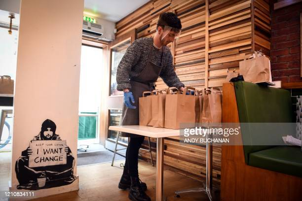 Manager of the Social Bite cafe Rory Bancroft prepares to distribute free lunches to homeless and needy customers from their cafe on Rose Street in...