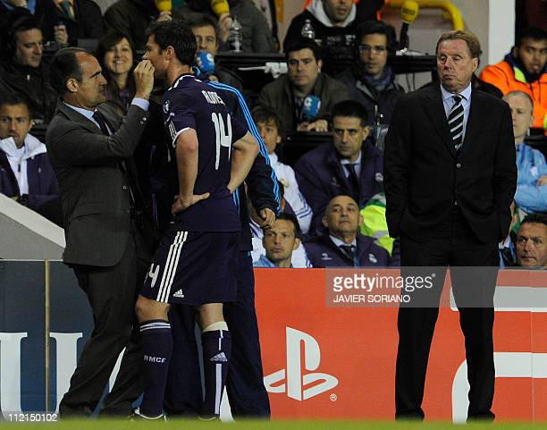 Manager of Tottenham Hotspur Harry Redknapp watches as Real Madrid's Xabi Alonso is treated during a UEFA Champions League Quarter Final 2nd leg...