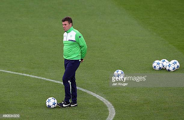 Manager of VfL Wolfsburg Dieter Hecking looks on during a VfL Wolfsburg training and press conference ahead of their Champions League fixture against...