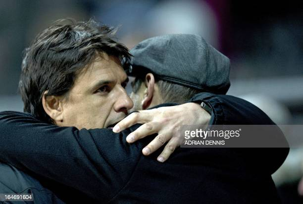 Manager of Wales Chris Coleman hugs Croatia's Coach Igor Stimac ahead of the FIFA 2014 World Cup qualifying football match between Wales and Croatia...