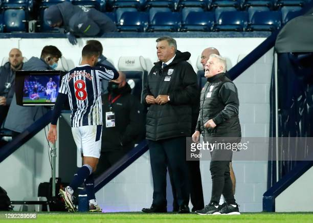 Manager of West Bromwich Albion, Sam Allardyce watches on as Jake Livermore of West Bromwich Albion walks off the pitch after receiving a red card...