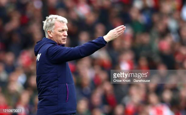Manager of West Ham David Moyes gestures during the Premier League match between Arsenal FC and West Ham United at Emirates Stadium on March 07 2020...