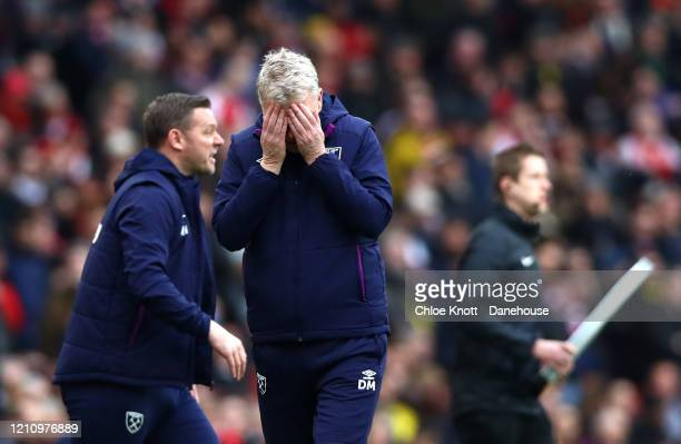 Manager of West Ham David Moyes reacts during the Premier League match between Arsenal FC and West Ham United at Emirates Stadium on March 07 2020 in...