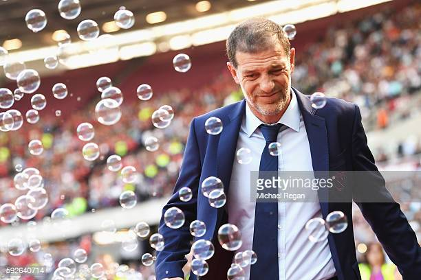 Manager of West Ham United Slaven Bilic looks on as bubbles are blown during the Premier League match between West Ham United and AFC Bournemouth at...