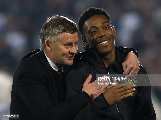 Manager Ole Gunnar Solskjaer and Anthony Martial of Manchester United walk off after the UEFA Europa League group L match between Partizan and...