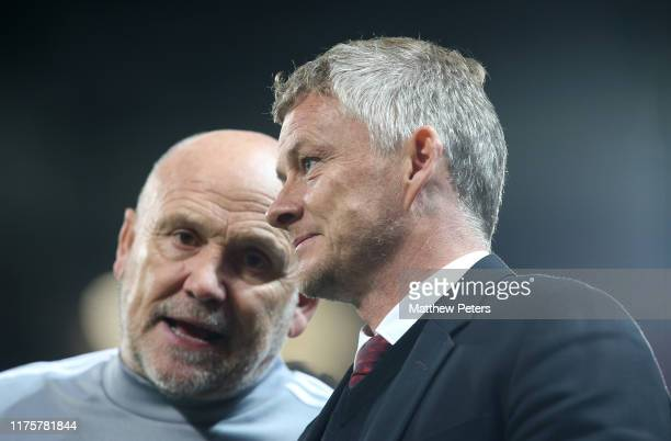 Manager Ole Gunnar Solskjaer and Assistant Manager Mike Phelan of Manchester United walk off after the UEFA Europa League group L match between...