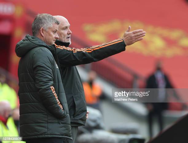 Manager Ole Gunnar Solskjaer and Assistant manager Mike Phelan of Manchester United watch from the touchline during the Premier League match between...