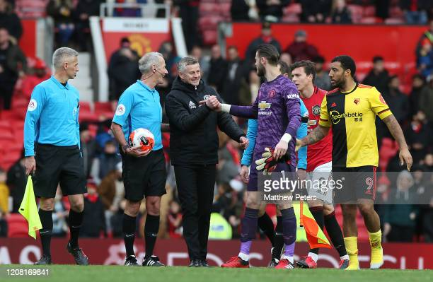 Manager Ole Gunnar Solskjaer and David de Gea of Manchester United walk off after the Premier League match between Manchester United and Watford FC...