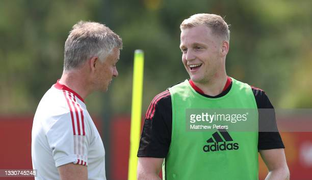Manager Ole Gunnar Solskjaer and Donny van de Beek of Manchester United in action during a first team training session at Carrington Training Ground...