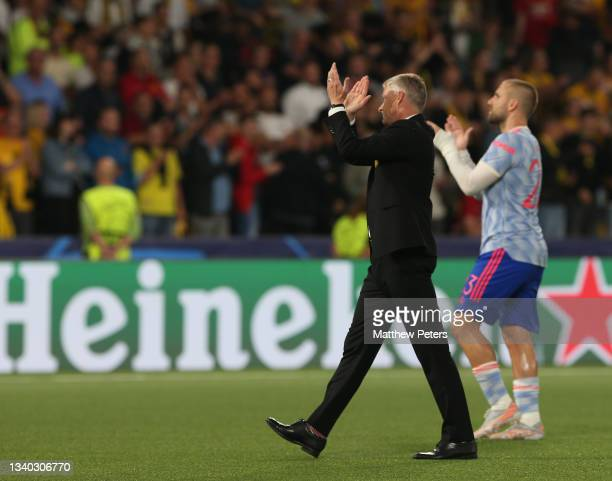 Manager Ole Gunnar Solskjaer and Luke Shaw of Manchester United applaud the fans after the UEFA Champions League group F match between BSC Young Boys...