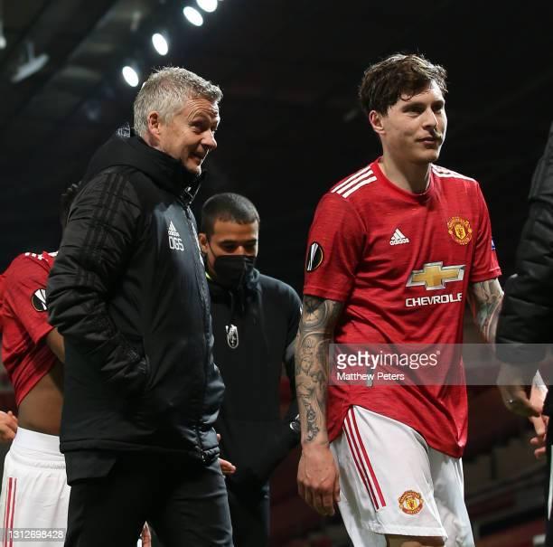 Manager Ole Gunnar Solskjaer and Victor Lindelof of Manchester United walk off after the UEFA Europa League Quarter Final Second Leg match between...