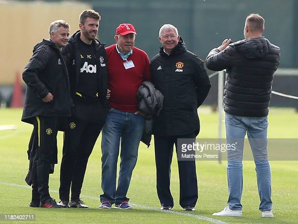 Manager Ole Gunnar Solskjaer Coach Michael Carrick and Sir Alex Ferguson of Manchester United U18s watches from the touchline during the U18 Premier...