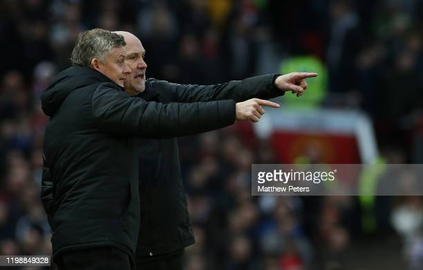 Manager Ole Gunnar Solskjaer of Manchester United and Assistant Manager Mike Phelan watch from the touchine during the Premier League match between...