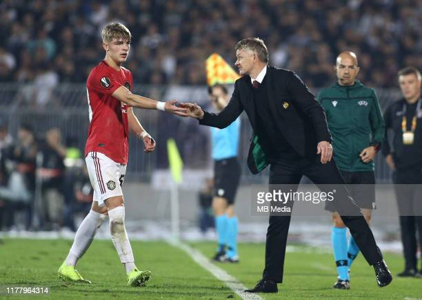 Manager Ole Gunnar Solskjaer of Manchester United and Brandon Williams of Manchester United during the UEFA Europa League group L match between...