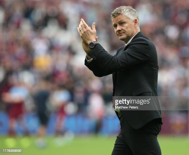 Manager Ole Gunnar Solskjaer of Manchester United applauds the fans after the Premier League match between West Ham United and Manchester United at...