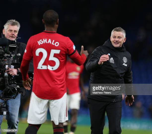 Manager Ole Gunnar Solskjaer of Manchester United celebrates with Odion Ighalo after the Premier League match between Chelsea FC and Manchester...