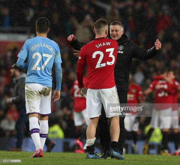 Manager Ole Gunnar Solskjaer of Manchester United celebrates with Luke Shaw after the Premier League match between Manchester United and Manchester...