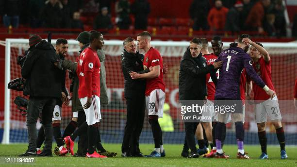 Manager Ole Gunnar Solskjaer of Manchester United celebrates with Scott McTominay after the Premier League match between Manchester United and...