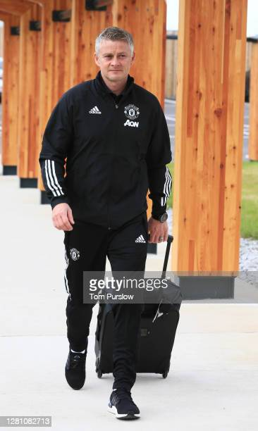 Manager Ole Gunnar Solskjaer of Manchester United checks in ahead of their flight to Paris at Manchester Airport on October 19 2020 in Manchester...