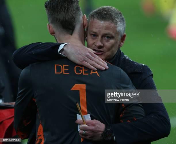 Manager Ole Gunnar Solskjaer of Manchester United consoles David de Gea after the UEFA Europa League Final between Villarreal CF and Manchester...