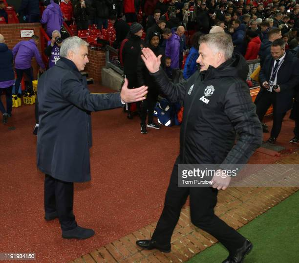 Manager Ole Gunnar Solskjaer of Manchester United greets Manager Jose Mourinho of Tottenham Hotspur ahead of the Premier League match between...