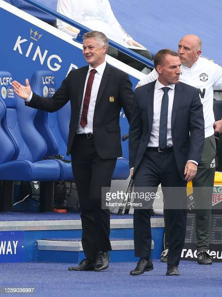 Manager Ole Gunnar Solskjaer of Manchester United greets Manager Brendan Rodgers of Leicester City ahead of the Premier League match between...