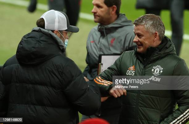 Manager Ole Gunnar Solskjaer of Manchester United greets Manager Jurgen Klopp of Liverpool ahead of the Emirates FA Cup Fourth Round match between...
