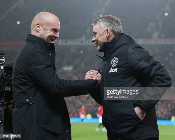 Manager Ole Gunnar Solskjaer of Manchester United greets Manager Sean Dyche of Burnley ahead of the Premier League match between Manchester United...