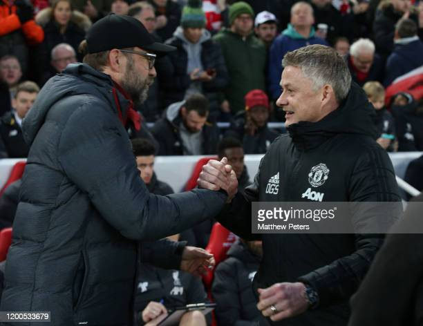 Manager Ole Gunnar Solskjaer of Manchester United is greeted by Manager Jurgen Klopp of Liverpool ahead of the Premier League match between Liverpool...