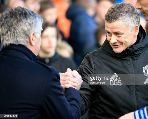 Manager Ole Gunnar Solskjaer of Manchester United is greeted by Manager Carlo Ancelotti of Everton ahead of the Premier League match between Everton...