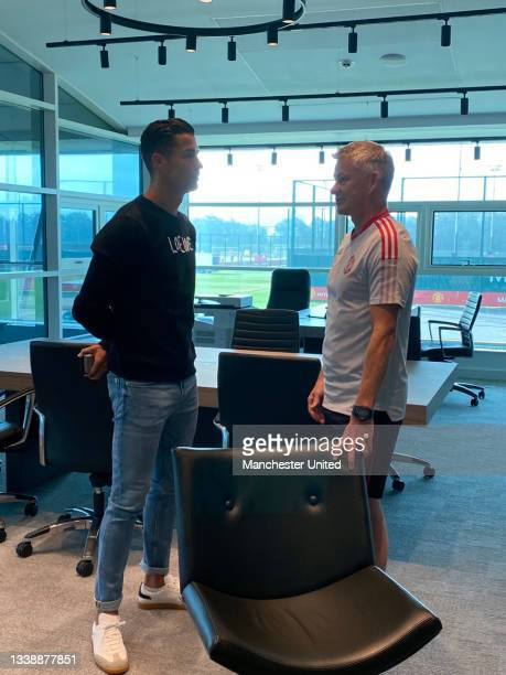 Manager Ole Gunnar Solskjaer of Manchester United meets Cristiano Ronaldo at Carrington Training Ground on September 07, 2021 in Manchester, England.