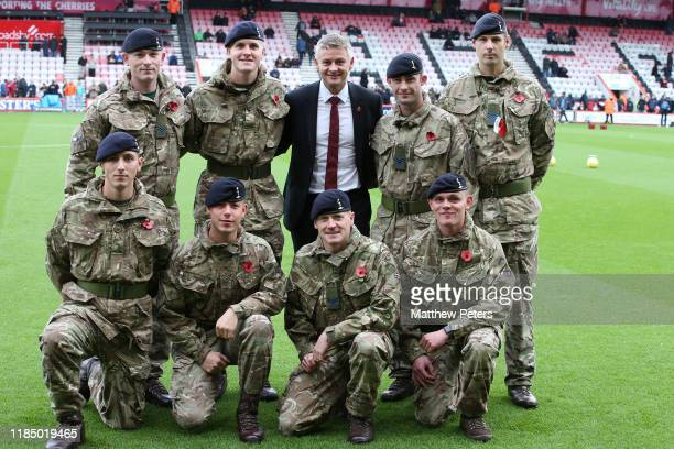 Manager Ole Gunnar Solskjaer of Manchester United poses with soldiers ahead of the Premier League match between AFC Bournemouth and Manchester United...