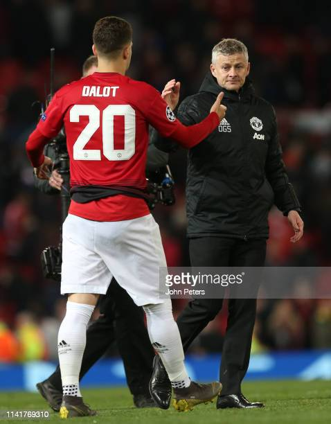 Manager Ole Gunnar Solskjaer of Manchester United shakes hands with Diogo Dalot after the UEFA Champions League Quarter Final first leg match between...