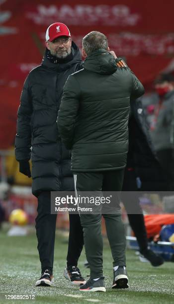 Manager Ole Gunnar Solskjaer of Manchester United speaks to Manager Jurgen Klopp of Liverpool after the Premier League match between Liverpool and...