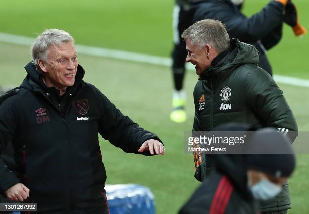 Manager Ole Gunnar Solskjaer of Manchester United speaks to Manager David Moyes of West Ham United ahead of The Emirates FA Cup Fifth Round match...