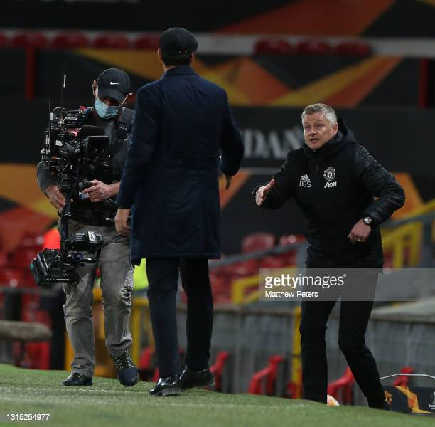 Manager Ole Gunnar Solskjaer of Manchester United speaks to Manager Paulo Fonseca of AS Roma after the UEFA Europa League Semi-final First Leg match...