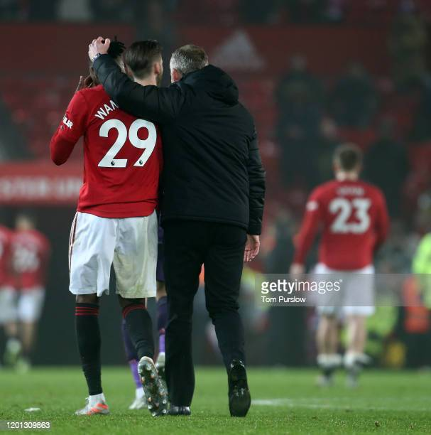 Manager Ole Gunnar Solskjaer of Manchester United walks off with Aaron Wan-Bissaka after the Premier League match between Manchester United and...